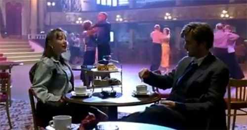 Lisa Millet, as Hailey, and David Tennant as detective Peter Carlisle, having tea and questions in the Blackpool Ballrom